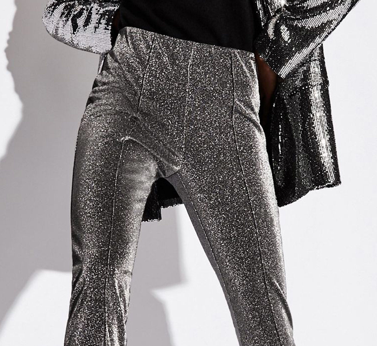 Armani Exchange woman model wearing a silver pants