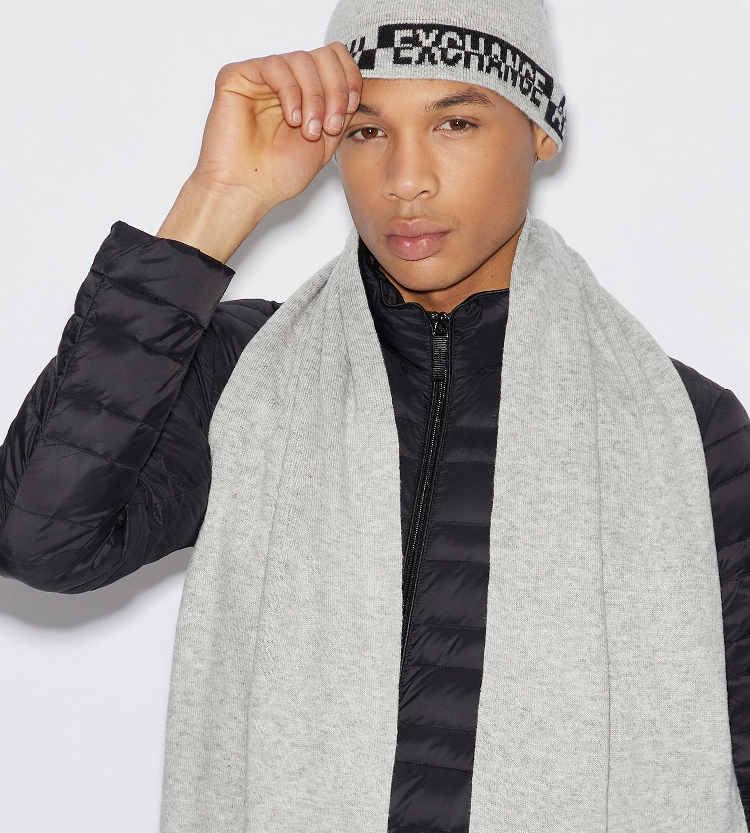 AX men model wearing logoed beanie and scarf