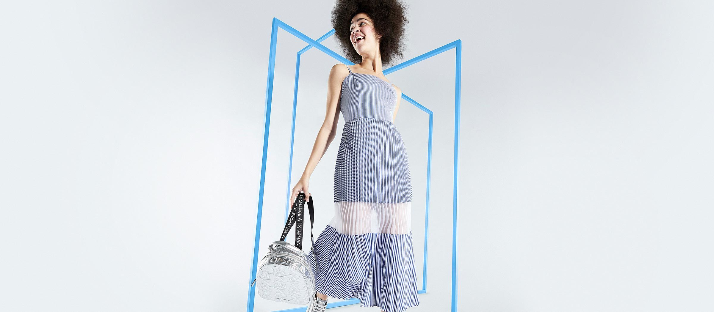 AX woman model wearing a striped dress