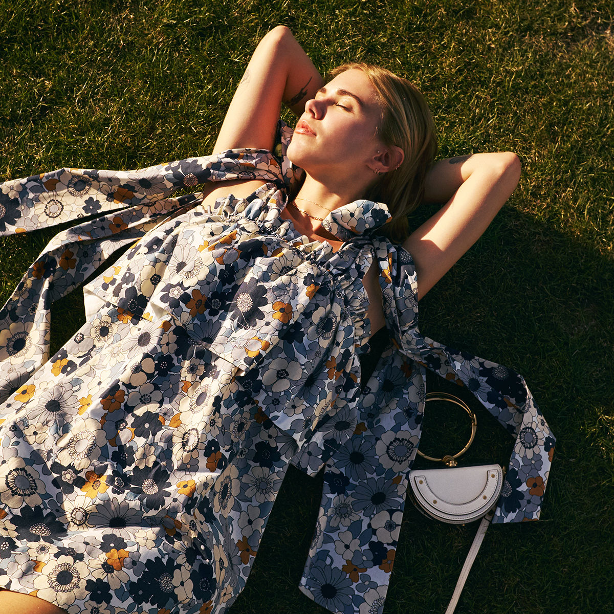 05ac1b0c2cc2 Courtney Trop catches the late afternoon sun in Spring-Summer 2017 florals.