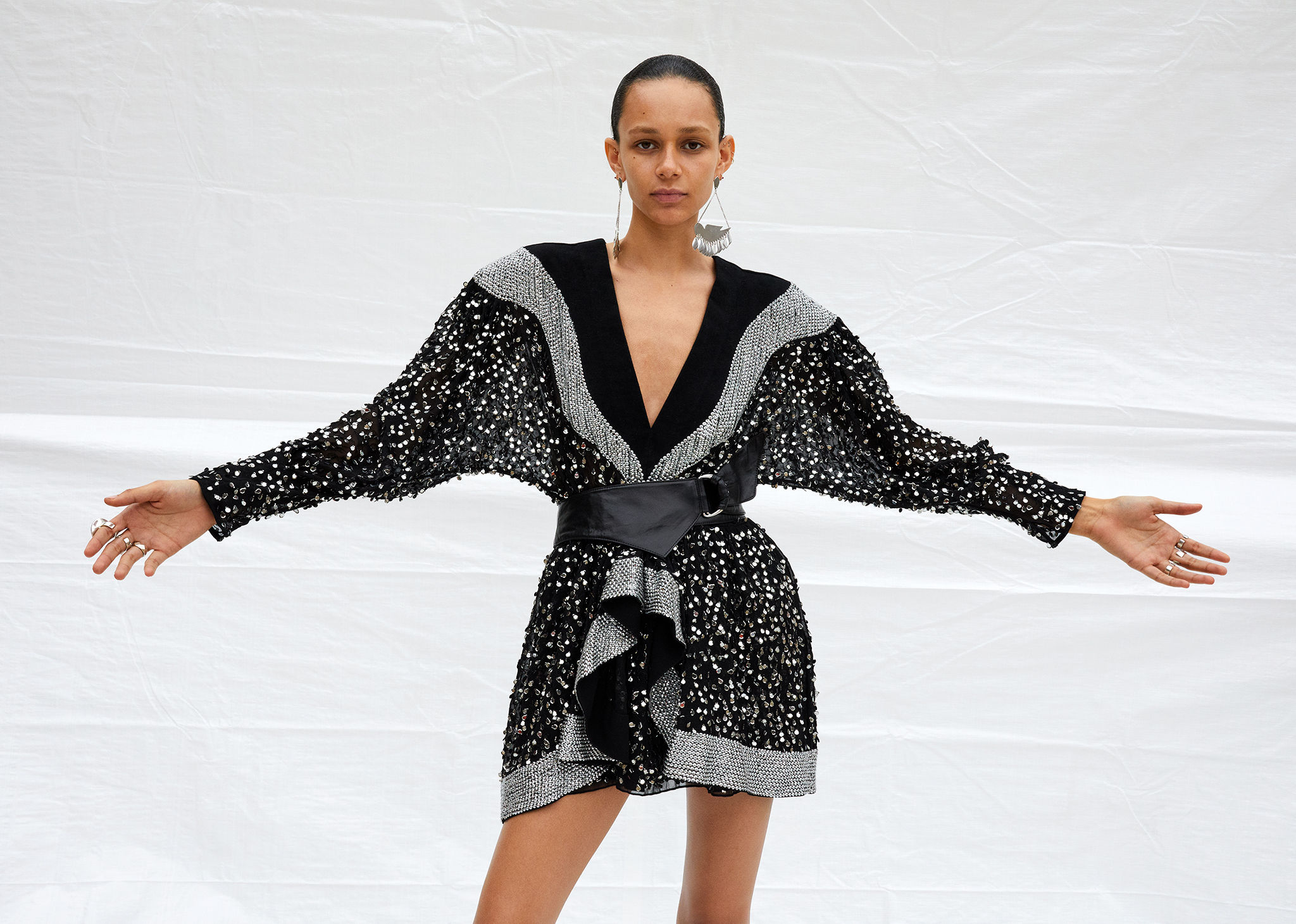The model is standing, arms raised on each side, wearing the Caldes dress. Click on this picture to see the Isabel Marant Winter 2019 runway selection.