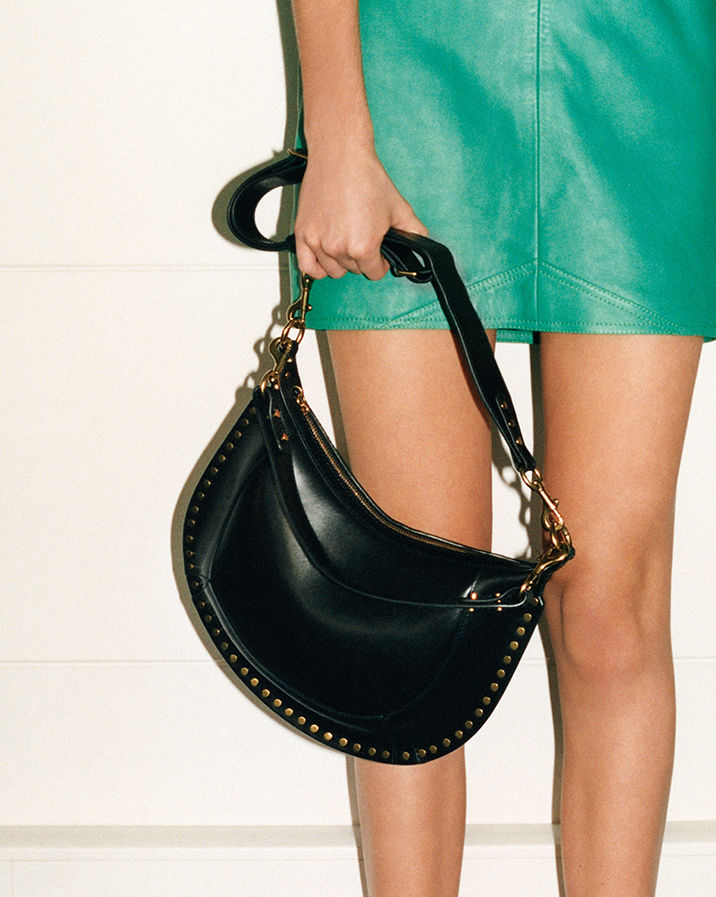 Model is wearing the Naoko bag.