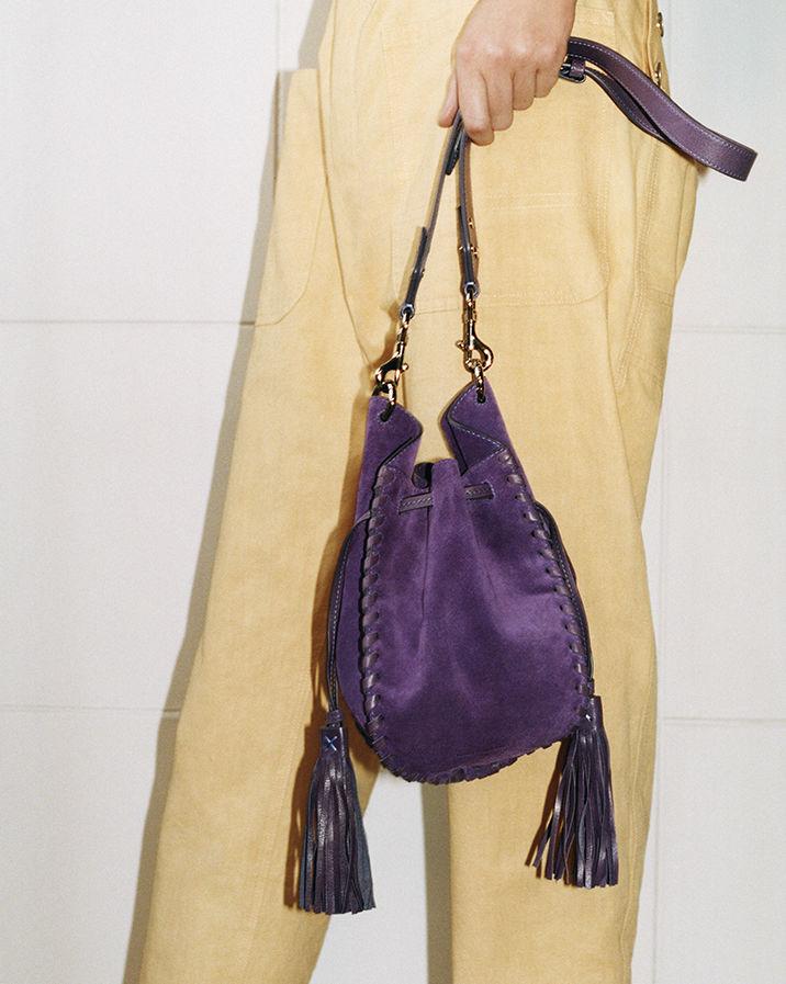 Model is wearing the Radja bag.