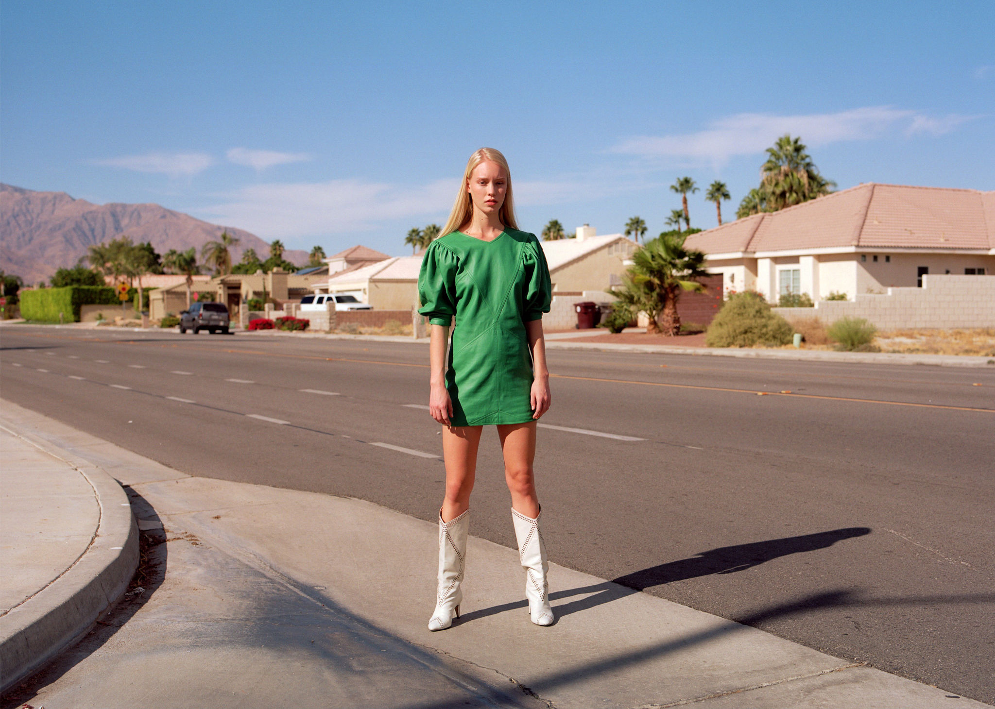 \'The model is standing on the road, wearing the Xadela dress and the Lahia boots. Click on this picture to see the new Isabel Marant Spring 2020 collection.
