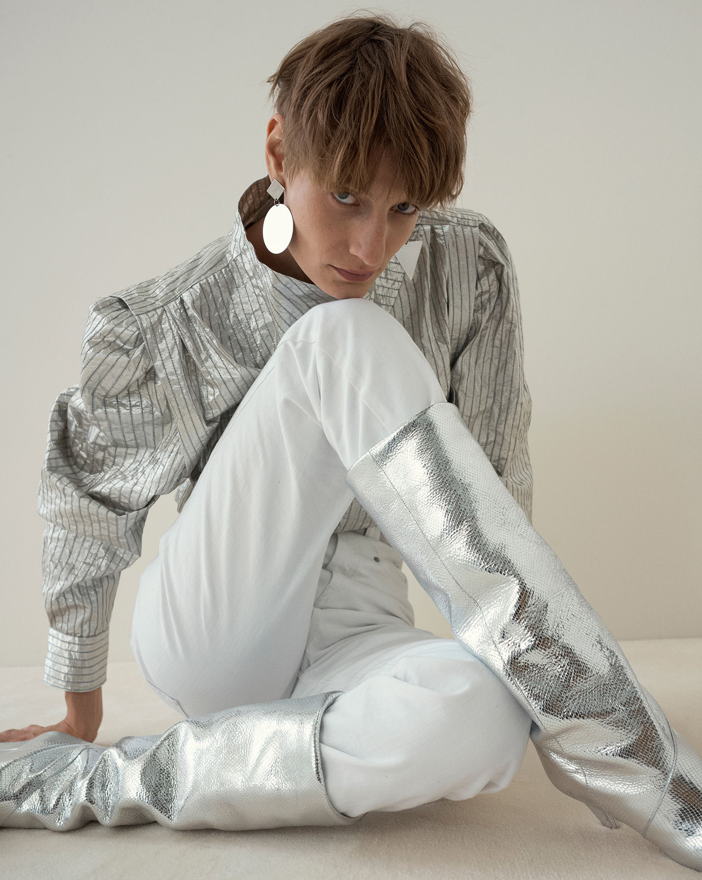 \'The model is sitting wearring the Romane top, Dominic trousers and Laomi boots.