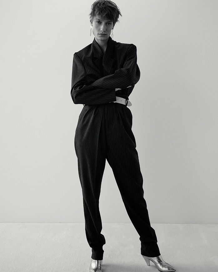 \'The model is standing wearing the Melinda jacket and Magali trousers.