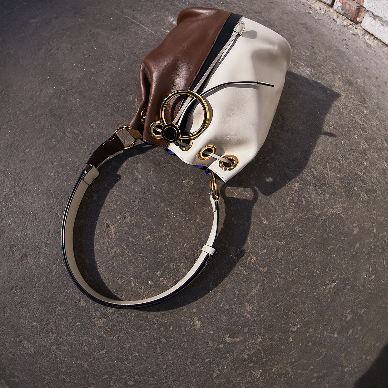 c18d4b9937bd Earring bagThe iconic gold-tone circle characterises new versions of the  must-have bag Discover