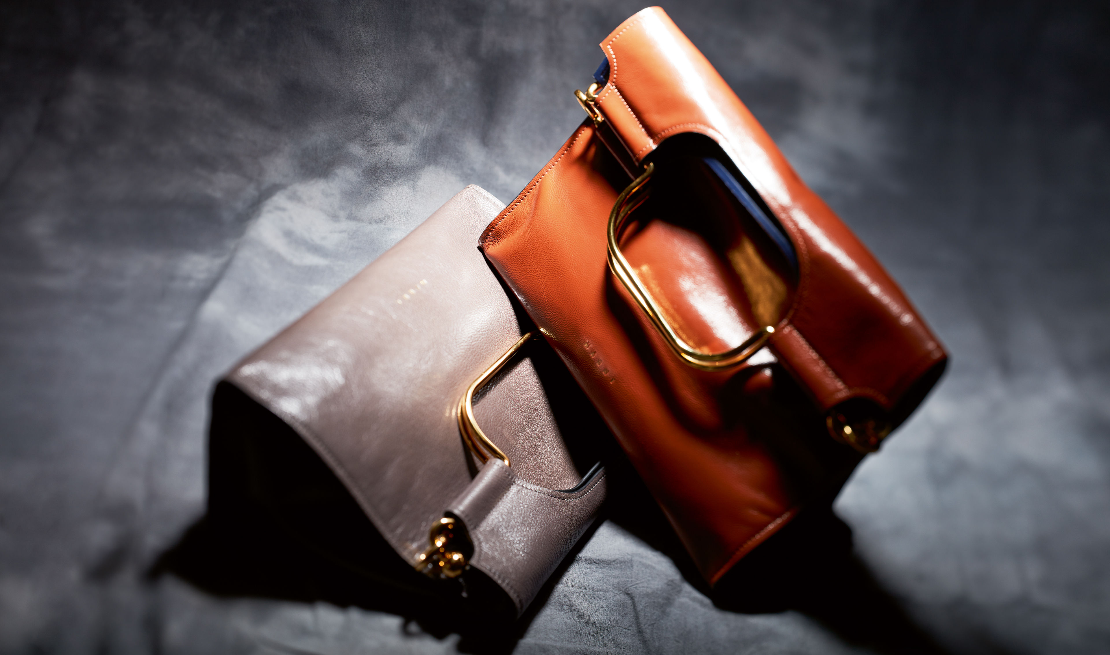 Marcel bag in brown and grey colour variations with golden handle