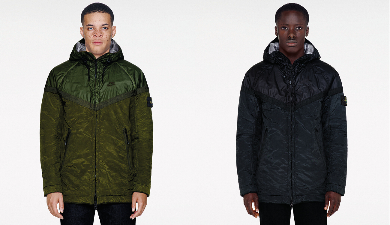 Two models, one wearing a green, monochrome Nike Windrunner jacket and one in a black, monochrome Nike Windrunner jacket.