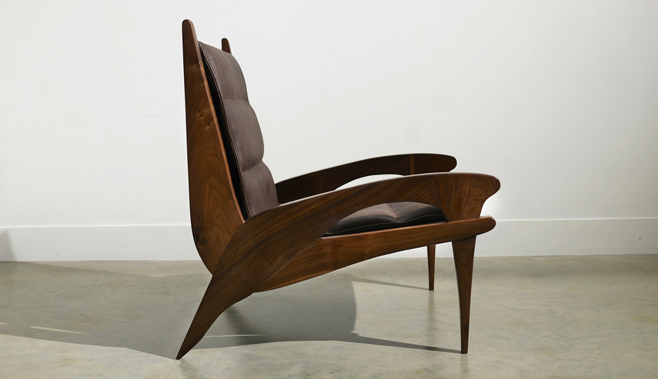 Dark brown, wood and leather armchair.