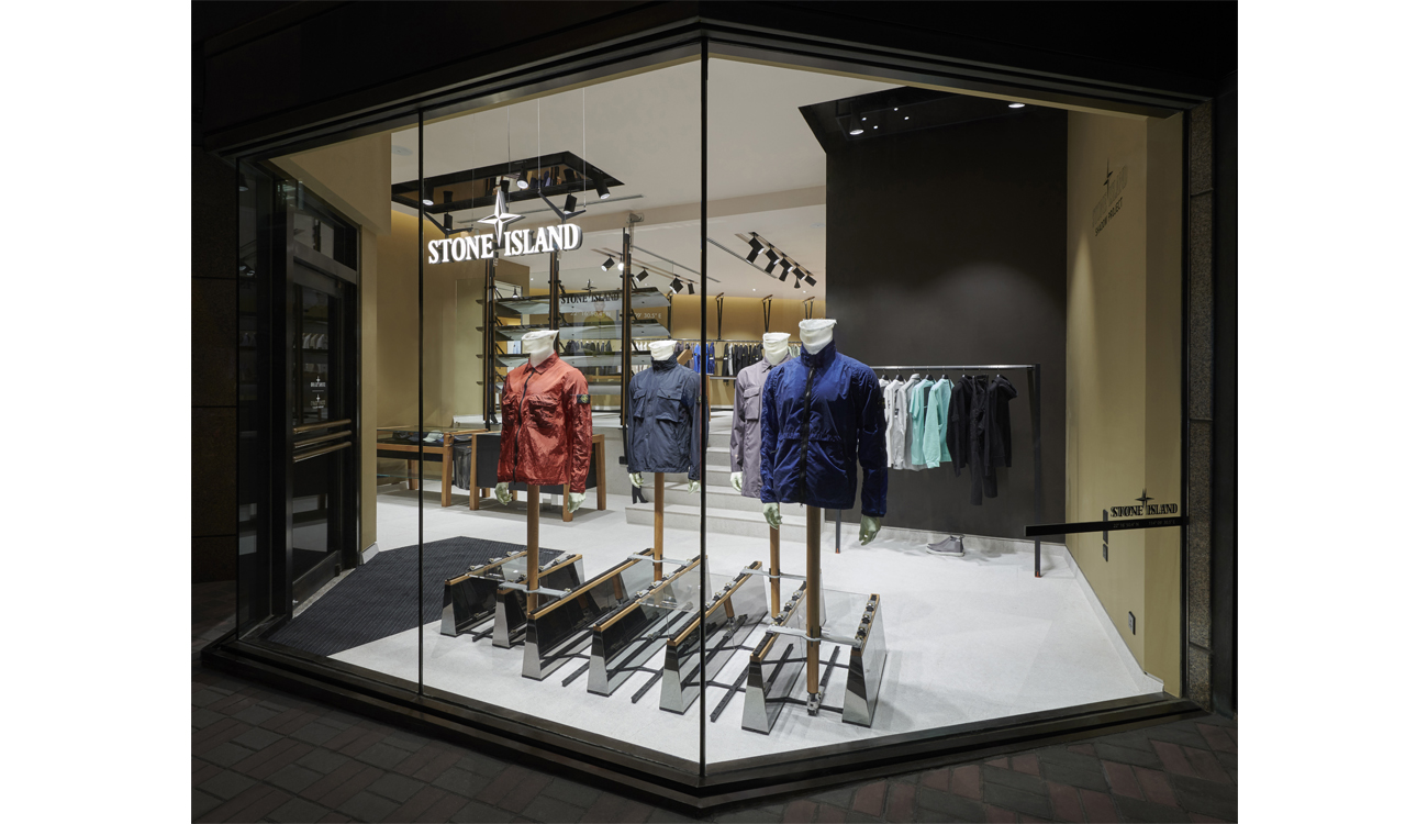 All glass store front through which can be seen a brightly lit store interior.