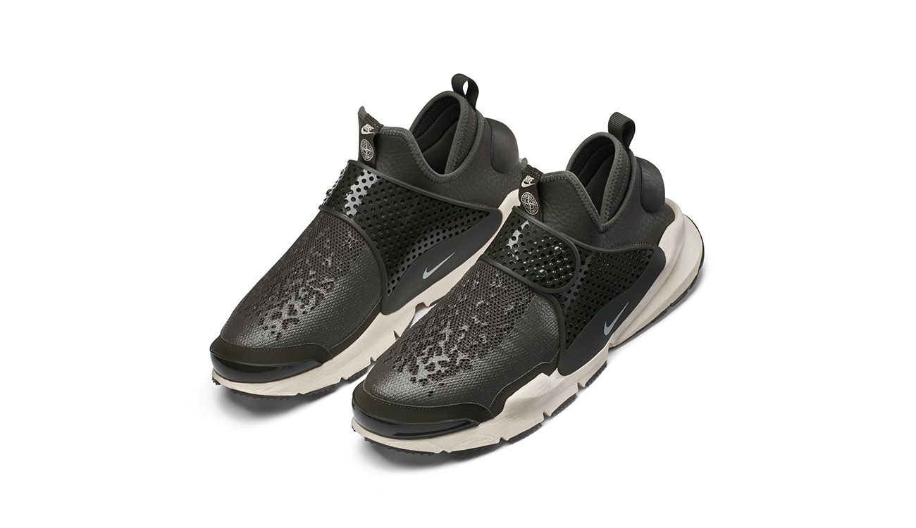 Pair of black, slip on sneakers in synthetic leather with mesh upper, midfoot strap and white, chunky outsole.