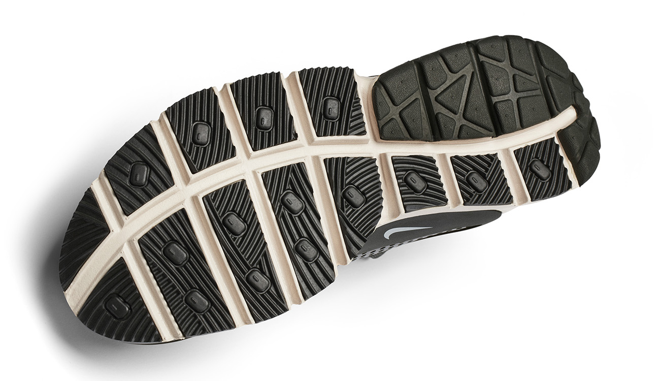 Bottom of sole of black, slip on sneaker in synthetic leather.