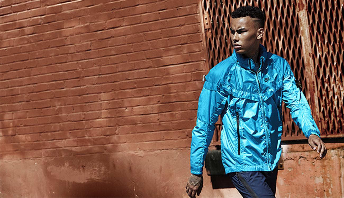 Model wearing a light blue, Windrunner jacket.