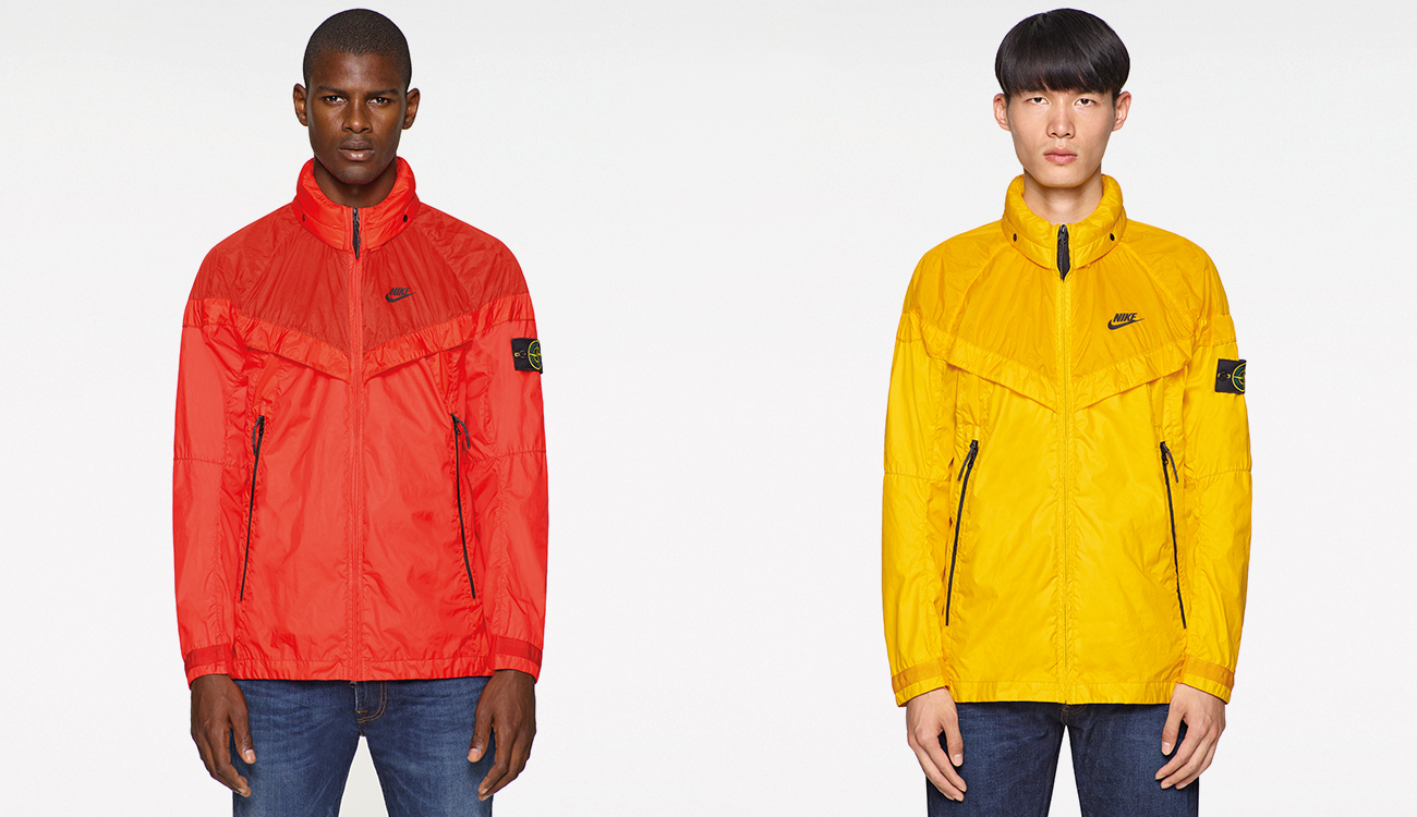 One model wearing a red Windrunner jacket and one model wearing a yellow one.