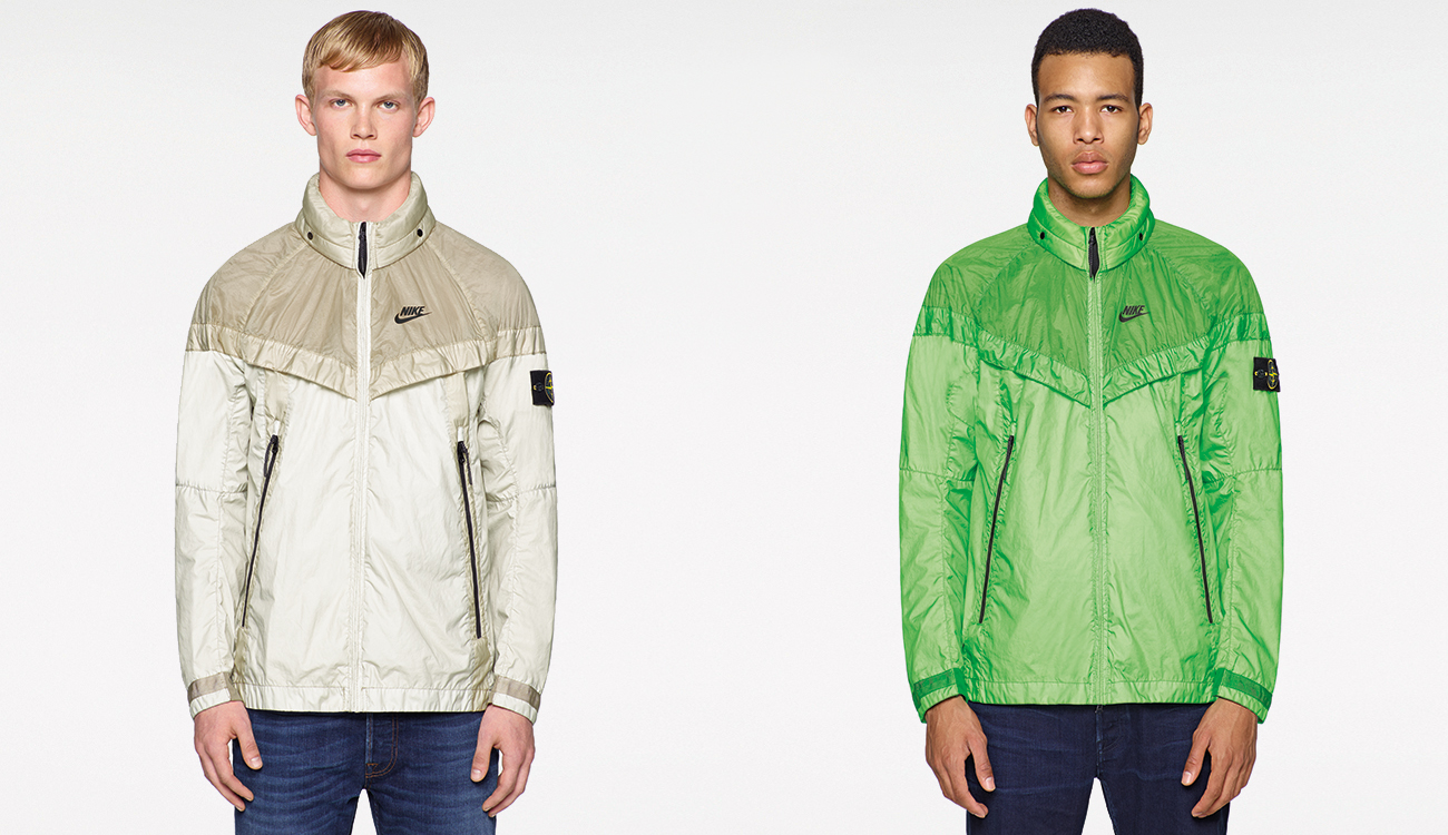 One model wearing a beige Windrunner jacket and one model wearing a green one.
