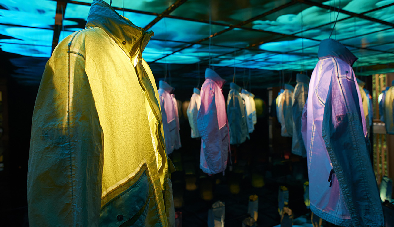 Artistic installation of jackets seen from the side.