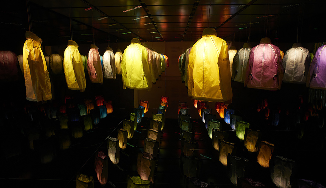 Artistic installation of jackets seen from the back.