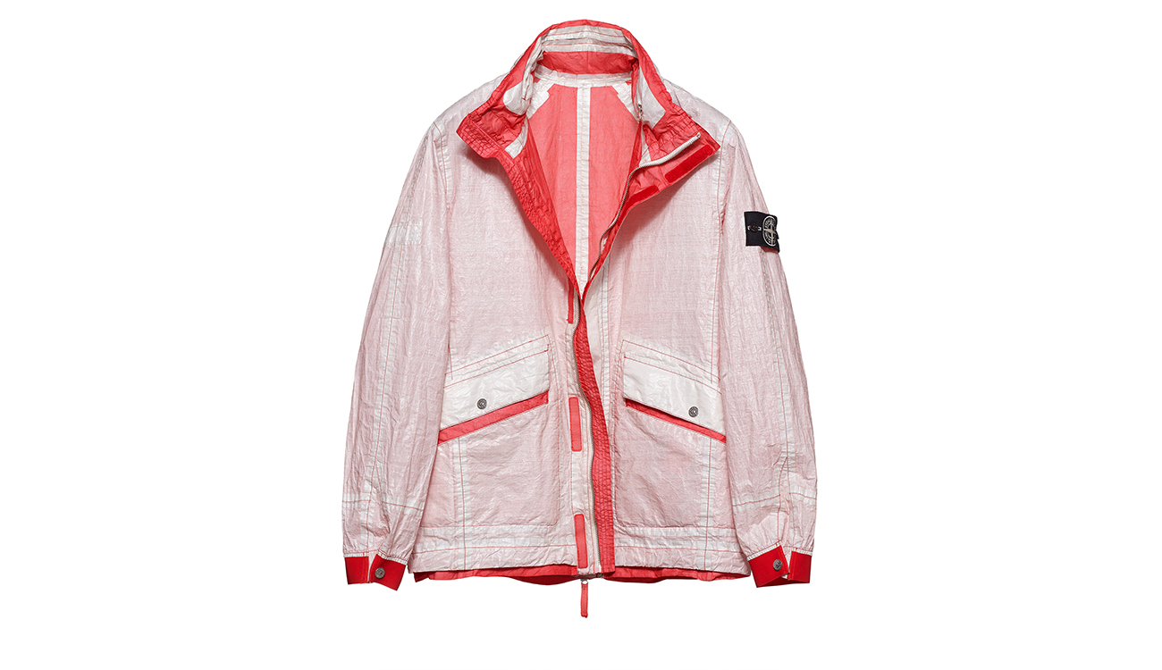 Reversible, lightweight jacket in Dyneema flexible composite fabric with one side in white and one in light red.