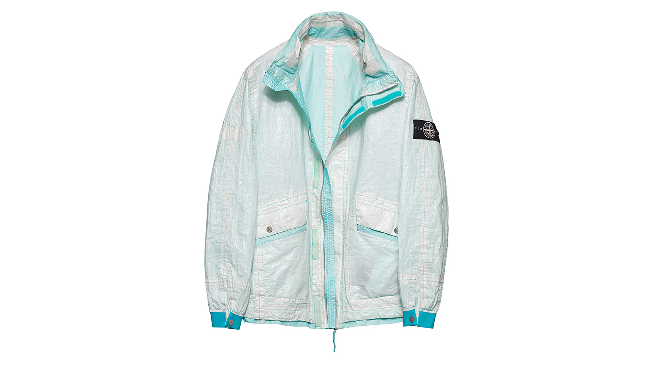 Reversible, lightweight jacket in Dyneema flexible composite fabric with one side in white and one in very light blue.