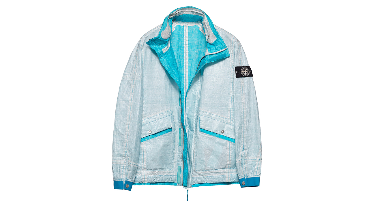 Reversible, lightweight jacket in Dyneema flexible composite fabric with one side in white and one in turquoise.