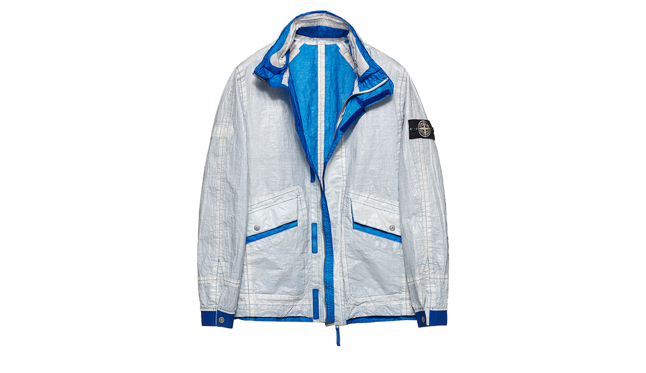 Reversible, lightweight jacket in Dyneema flexible composite fabric with one side in white and one in bright blue.