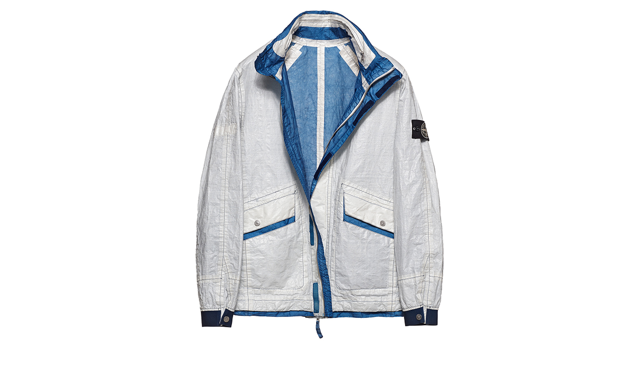 Reversible, lightweight jacket in Dyneema flexible composite fabric with one side in white and one in blue.
