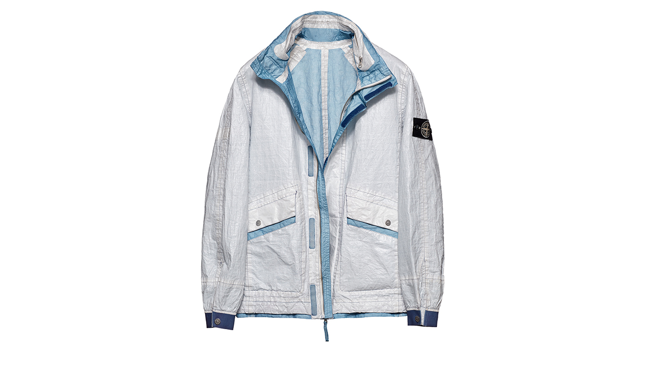 Reversible, lightweight jacket in Dyneema flexible composite fabric with one side in white and one in baby blue.