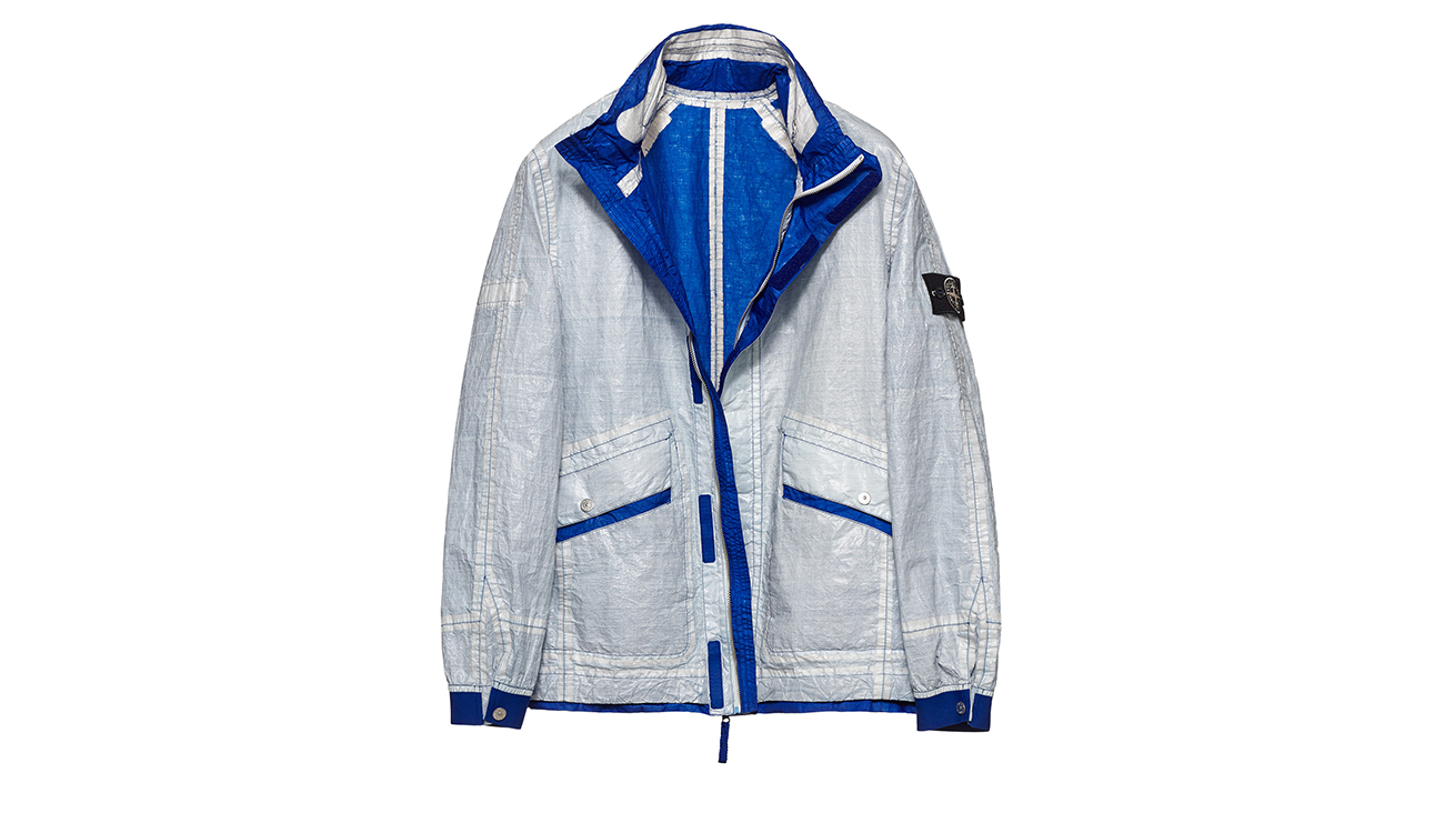 Reversible, lightweight jacket in Dyneema flexible composite fabric with one side in white and one in royal blue.
