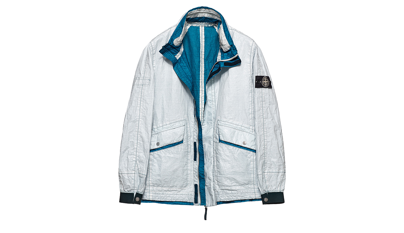 Reversible, lightweight jacket in Dyneema flexible composite fabric with one side in white and one in teal blue.