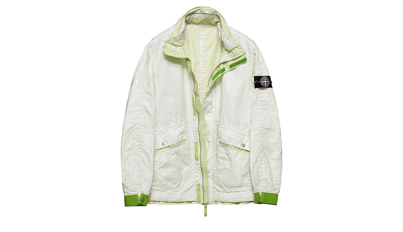 Reversible, lightweight jacket in Dyneema flexible composite fabric with one side in white and one in lime green.