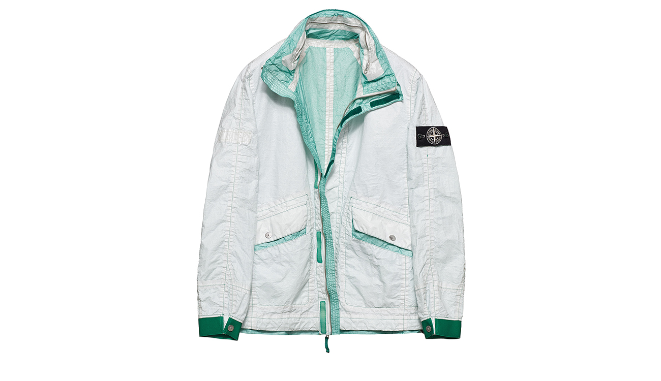 Reversible, lightweight jacket in Dyneema flexible composite fabric with one side in white and one in light aquamarine.