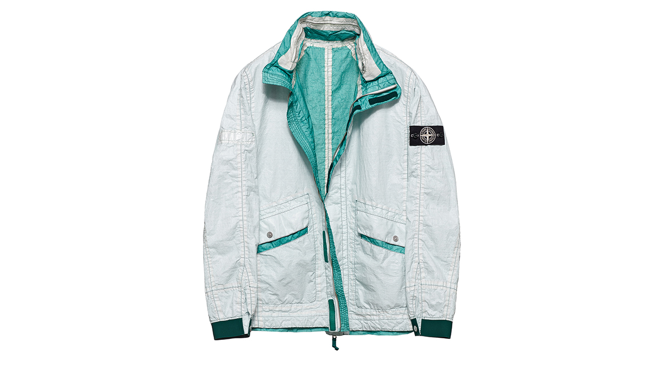 Reversible, lightweight jacket in Dyneema flexible composite fabric with one side in white and one in deep aquamarine.