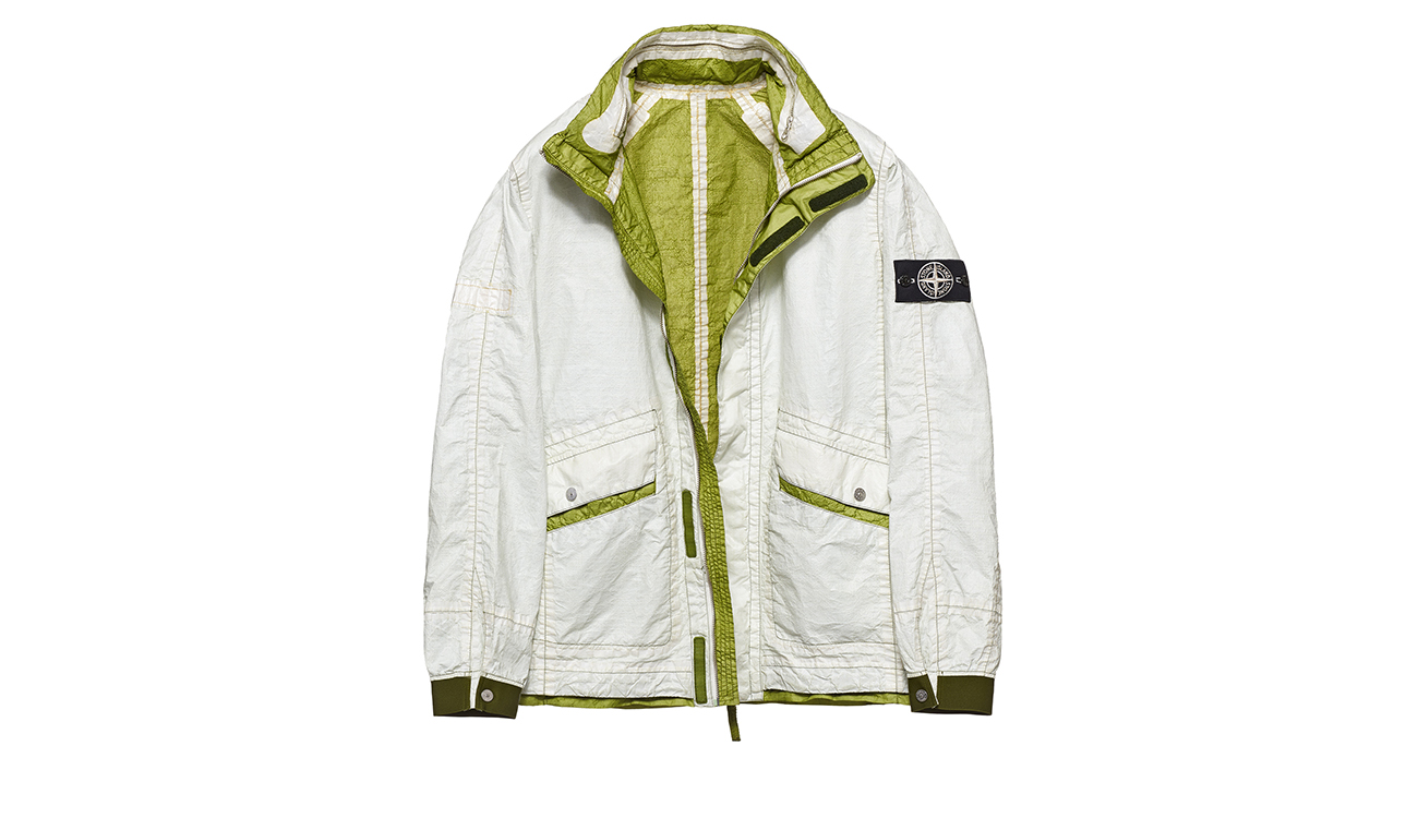Reversible, lightweight jacket in Dyneema flexible composite fabric with one side in white and one in olive green.