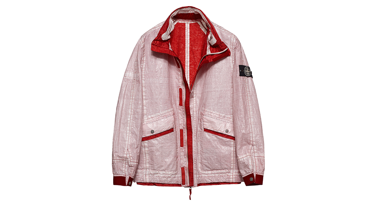 Reversible, lightweight jacket in Dyneema flexible composite fabric with one side in white and one in brick red.