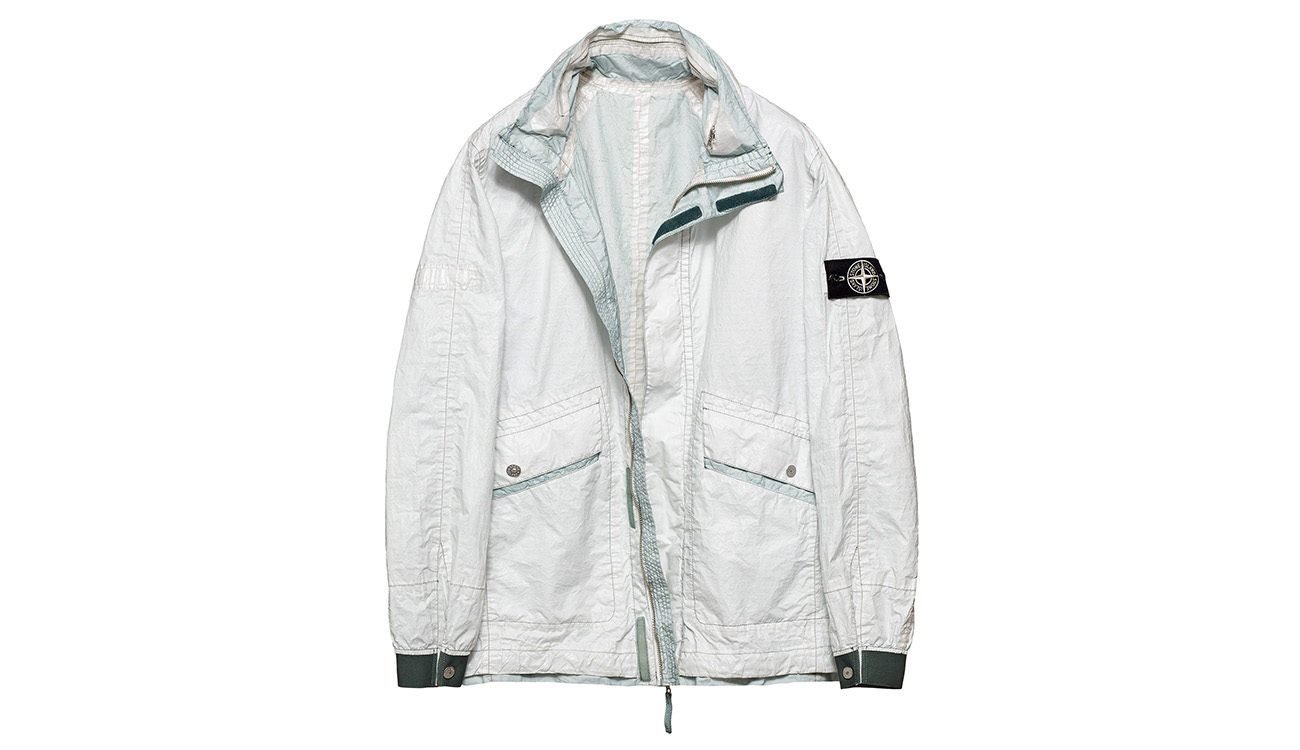 Reversible, lightweight jacket in Dyneema flexible composite fabric with one side in white and one in very pale aquamarine.
