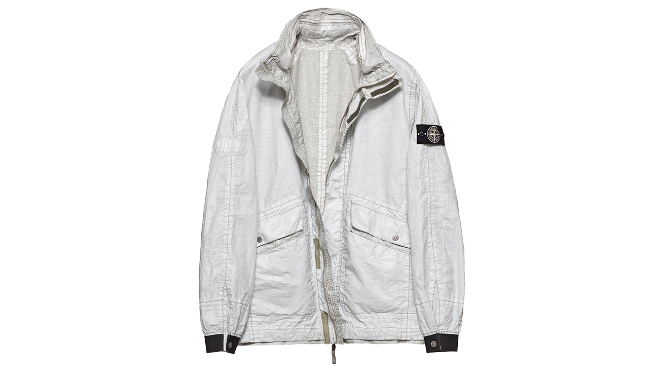 Reversible, lightweight jacket in Dyneema flexible composite fabric with one side in white and one in pale gray.