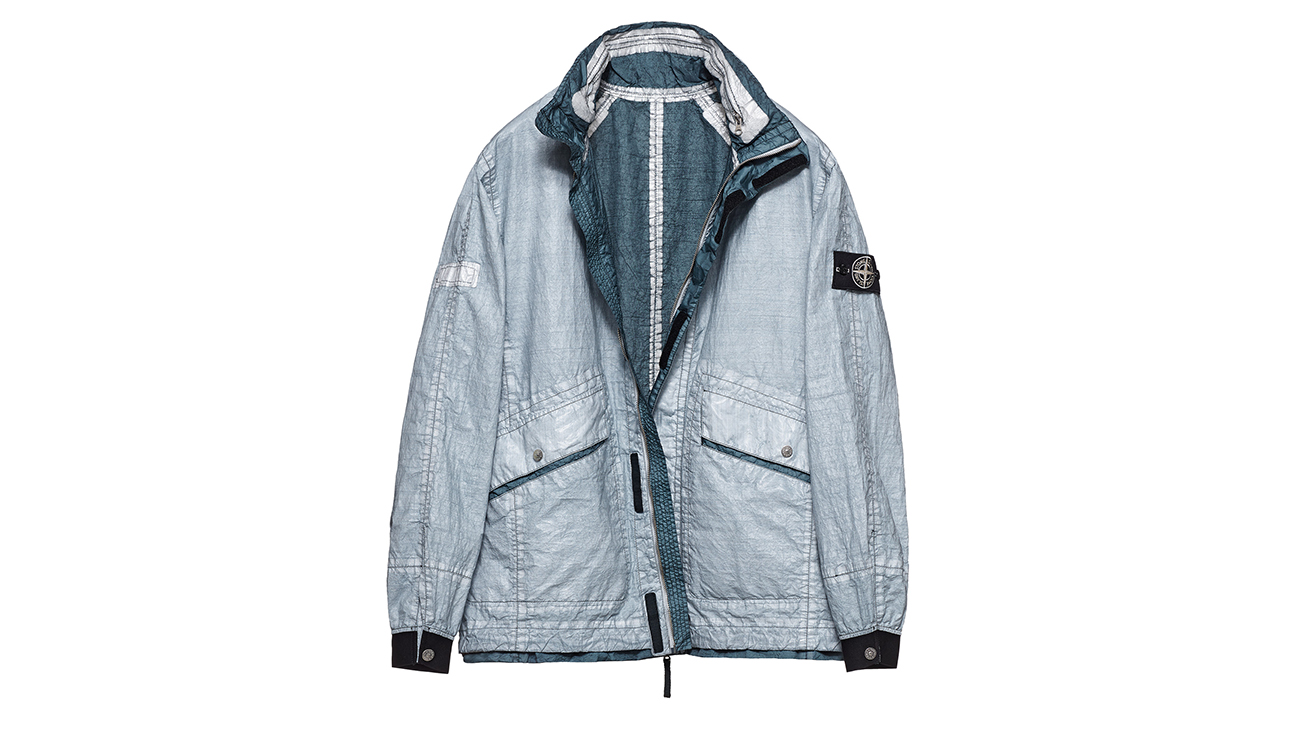 Reversible, lightweight jacket in Dyneema flexible composite fabric with one side in white and one in dark teal.