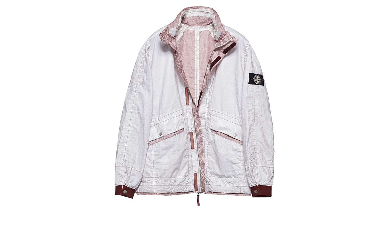 Reversible, lightweight jacket in Dyneema flexible composite fabric with one side in white and one in pale rose pink.