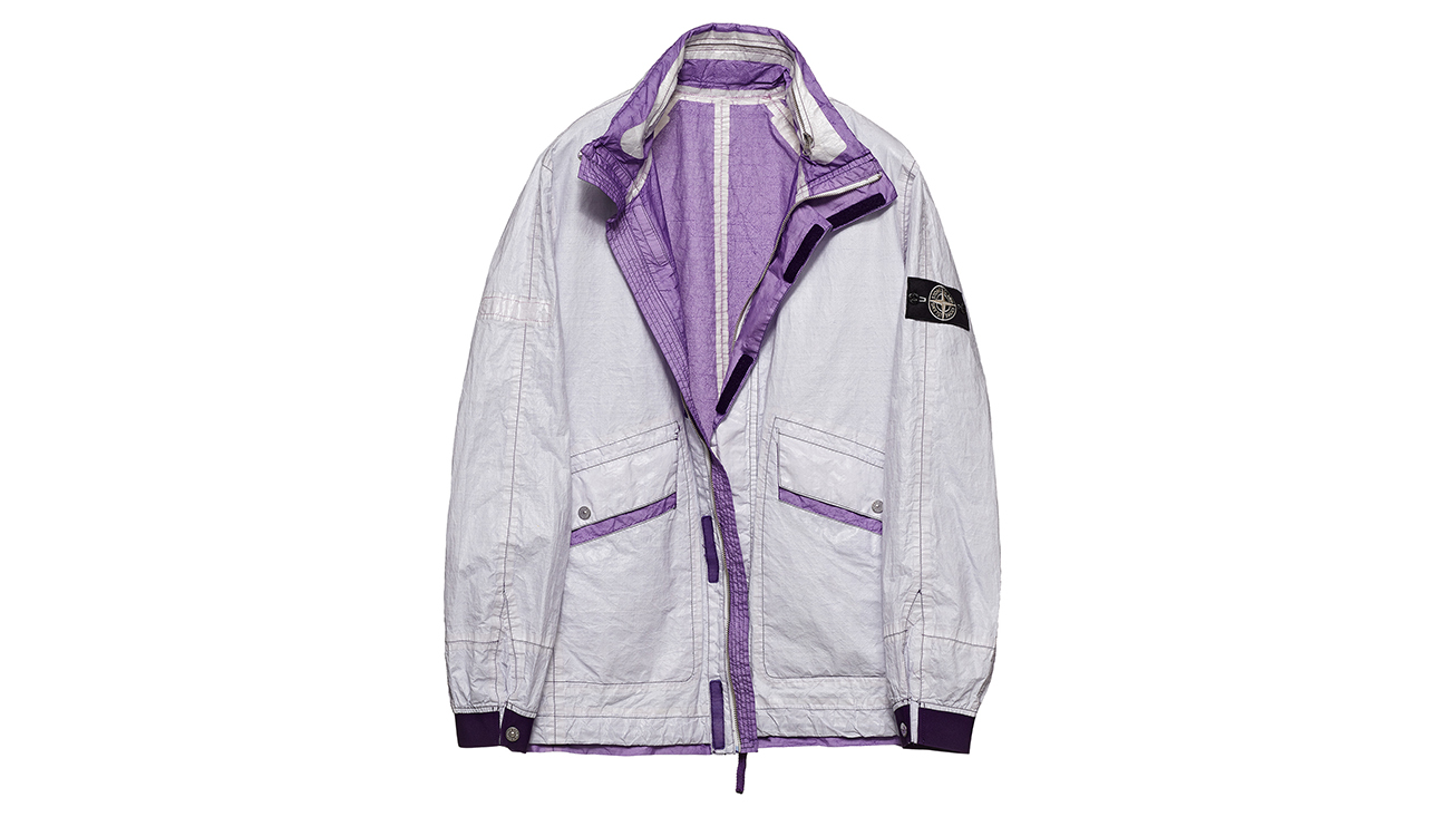 Reversible, lightweight jacket in Dyneema flexible composite fabric with one side in white and one in violet.