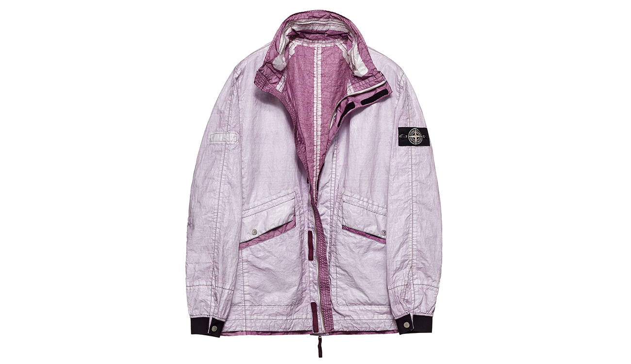 Reversible, lightweight jacket in Dyneema flexible composite fabric with one side in white and one in plum.