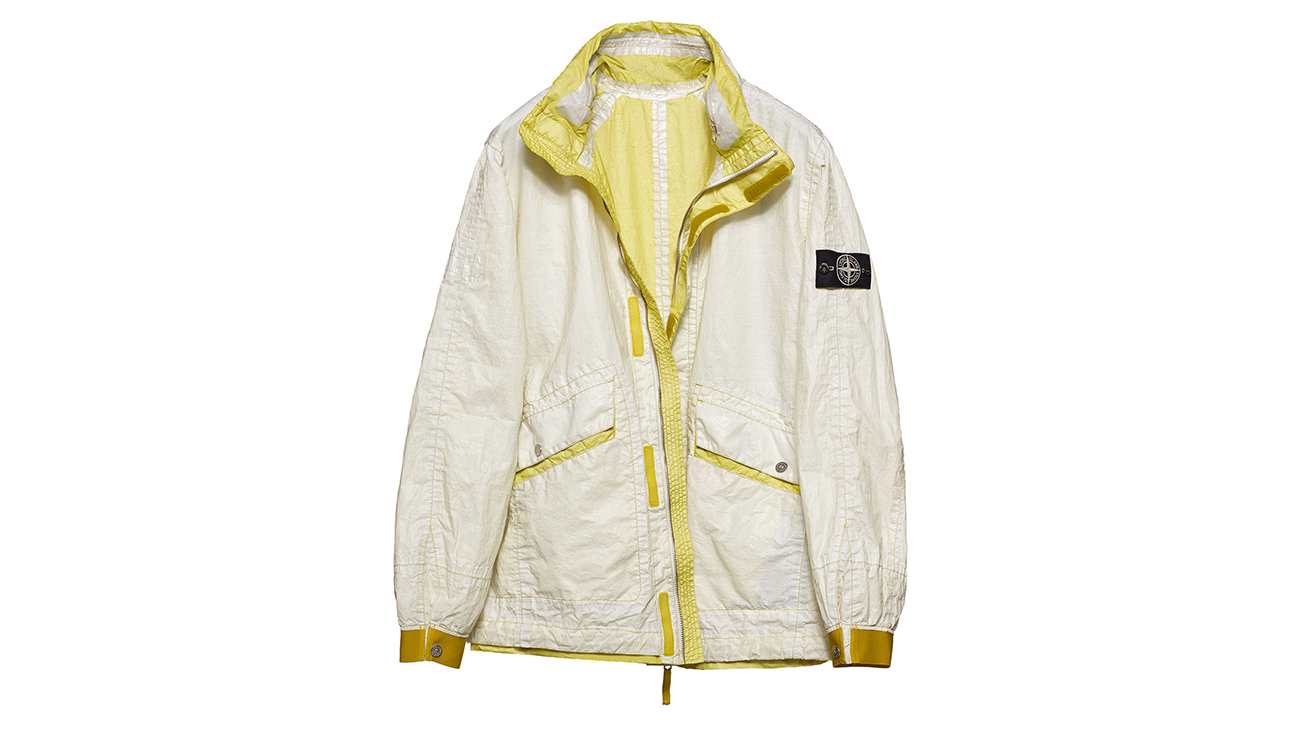 Reversible, lightweight jacket in Dyneema flexible composite fabric with one side in white and one in lemon yellow.