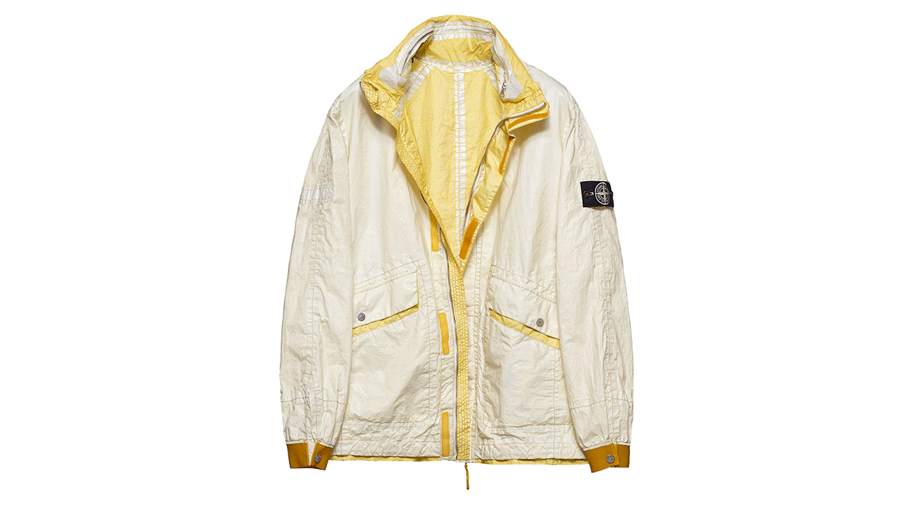 Reversible, lightweight jacket in Dyneema flexible composite fabric with one side in white and one golden yellow.