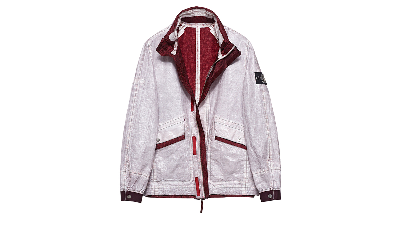 Reversible, lightweight jacket in Dyneema flexible composite fabric with one side in white and one in maroon.