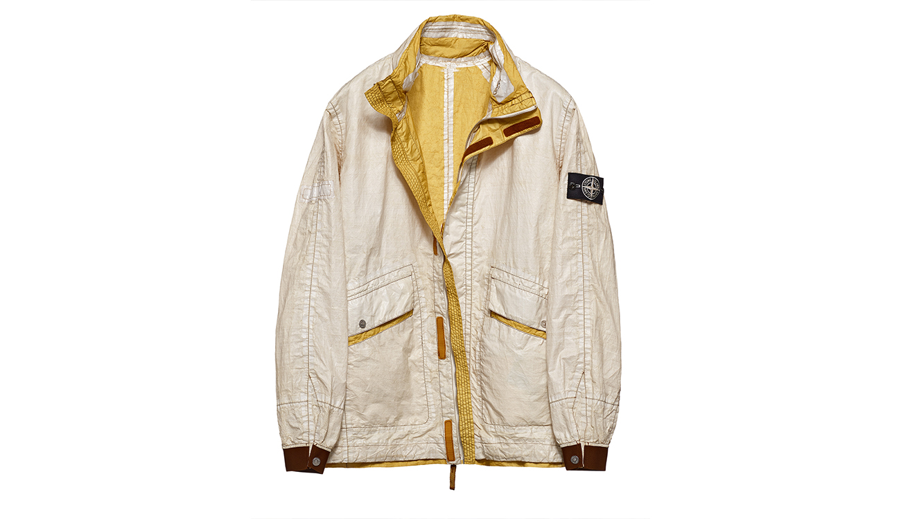 Reversible, lightweight jacket in Dyneema flexible composite fabric with one side in white and one bronze yellow.