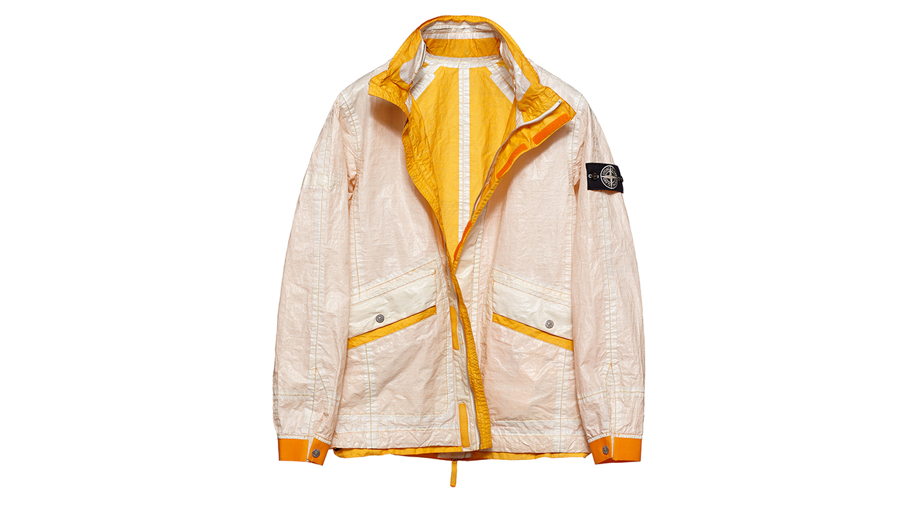 Reversible, lightweight jacket in Dyneema flexible composite fabric with one side in white and one in yellow.