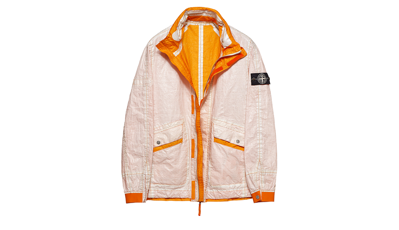 Reversible, lightweight jacket in Dyneema flexible composite fabric with one side in white and one in light orange.
