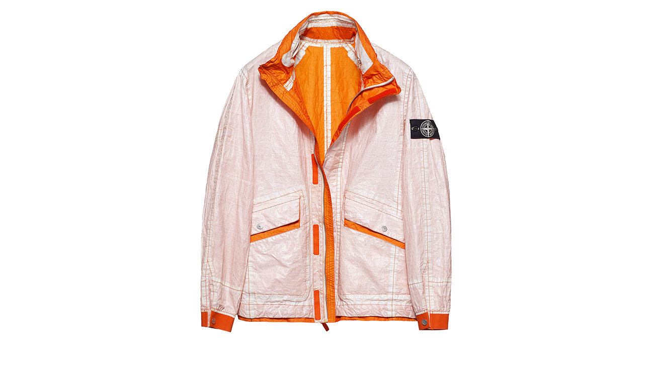 Reversible, lightweight jacket in Dyneema flexible composite fabric with one side in white and one in orange.