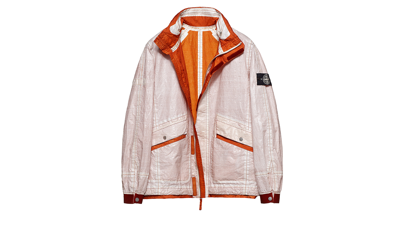 Reversible, lightweight jacket in Dyneema flexible composite fabric with one side in white and one in dark orange.