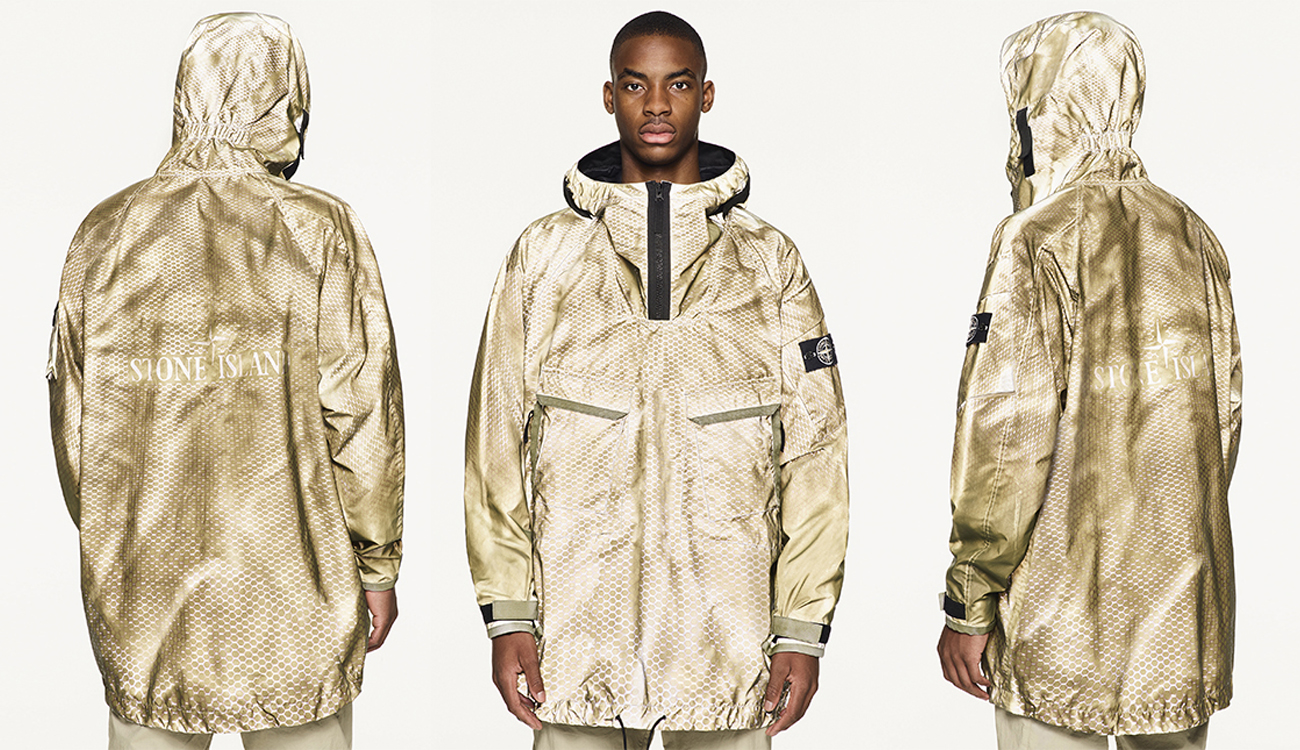 Three views of model in two tone gold anoraks. Two showing the lasered Stone Island logo on the back and one showing diagonal pockets and zip closure on the front.